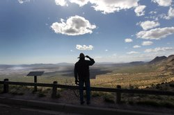 Rancher Geoffrey Patch looks over the border between the United States and Mexico on May 2, 2010 from Montezuma Pass, Arizona.