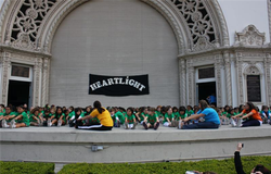 Children stretch as they participate in a Heartlight USA program.
