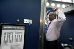 A Transportation Security Administration (TSA) volunteer demonstrates a full-body scanner at O'Hare International Airport on March 15, 2010 in Chicago, Illinois.