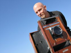 Photographer David Fokos with the 80-year-old, large format camera he shoots with.