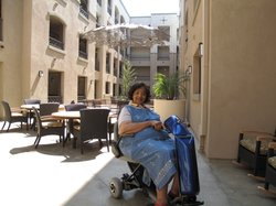 Resident Anita Estes sits in the courtyard of the new, eco-friendly Courtyard Terraces in City Heights, May 20, 2010.