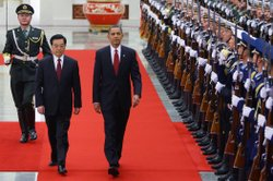 U.S. President Barack Obama (R) inspects a guard of honor along with Chinese President Hu Jintao (L) at the Great Hall of the People on November 17, 2009 in Beijing, China.