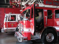 San Diego Fire and Rescue Department Truck 10 sits in a fire station garage . 