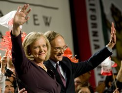 Republican gubernatorial candidate Meg Whitman with her husband Griffith Harsh (R) waves to supporters at her primary night party at the Universal Hilton Hotel June 8, 2010 in Los Angeles, California.