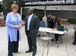 Councilwoman Marti Emerald and Mitch Mitchell, spokesman for the San Diego Food Bank, talk during the kickoff of the food stamp project on June 10, 2010.