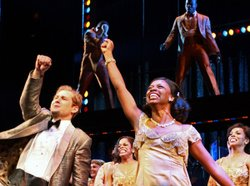 "Stars Chad Kimball (as Huey) and Montego Glover (as Felicia) take their curtain call during a performance of ""Memphis"" at Broadway's Shubert Theatre."