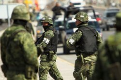Members of the Mexican military police keep guard at the scene of the murder of two women aged 17 and 21 March 24, 2010 in Juarez, Mexico.