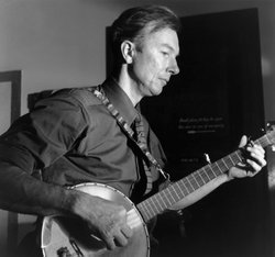 A black and white photo of Pete Seeger playing the banjo