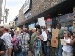 "Protesters for and against a controversial bumper sticker that reads ""Welcome to Ocean Beach/Please don't feed our bums"" gather in front of a store that sells the stickers on June 23, 2010 in Ocean Beach."