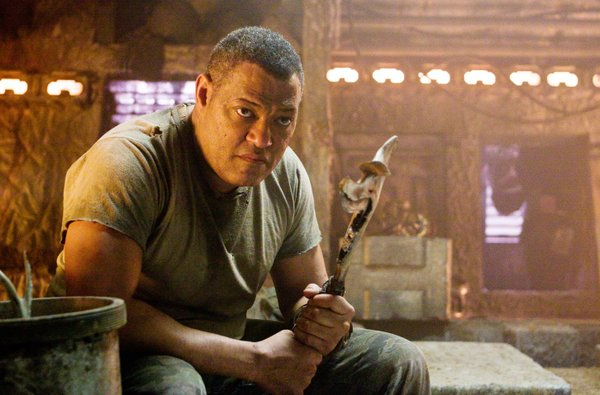 "Laurence Fishburne as a man who manages to evade the ""Predators"""