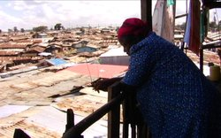 Silva Adhiambo looking over Kibera from a balcony. Silva's home and business in Africa's largest shantytown are being demolished as part of a U.N. slum-upgrading project.