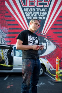 Artist Shepard Fairey stands in front of his work on the side of Urban Outfitters in Hillcrest.  Fairey is in town for MCASD&#39;s new exhibit &quot;Viva la Revolucin: A Dialogue with the Urban Landscape.&quot; 