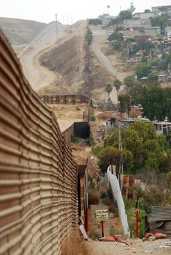 Tijuana's Colonia Libertad neighborhood butts up against the border fence. This is where Rogelio Mendez first crossed the border illegally in 1974. He says then you could cross where you wanted to.