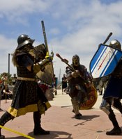 SCA members fight with swords (made of rattan) and real armor (very heavy). They claim to recreate the fun parts of medieval society, like feasts, costumes and sword fighting, and leave out plagues, lice, and beheadings.