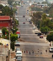 Kids play soccer in the street in Tijuana. Mexicans around the world sent home $21 billion in 2009.