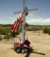 A cross stands where Border Patrol Agent Robert Wimer Rosas Jr. was killed while attempting to apprehend a group of people crossing the border on July 23, 2009. Christian Daniel Castro-Alvarez, 17 years old, confessed to the crime and was sentenced to 40 years to prison.
