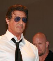 Sylvester Stallone making a proud exit from a crowd pleasing panel. (Photo by: Tony Weidinger)