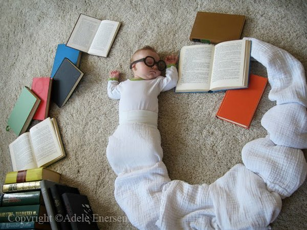 One of my favorites, baby Mila as a bookworm.  Conceived and photographed by Mila's mother, Adele Enersen.
