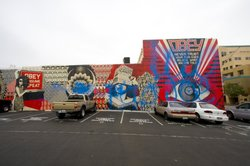 Wide shot of the Shepard Fairey mural in Hillcrest that was tagged last night with blue spray paint.