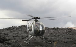 Geologists investigating the Kilauea volcano on the big island of Hawaii arrive for work by chopper.