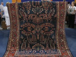 "A Sarouk carpet, a rug that woven in northwest Persia in the 1920s. At the Midwest Airlines Center, ""Roadshow"" experts pave the way for some unique discoveries, including this valuable Persian rug the owner used to cover furniture in the rain."