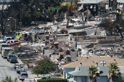 Firefighters sift through rubble at a burned home that was destroyed by a massive explosion and fire September 10, 2010 in San Bruno, California.