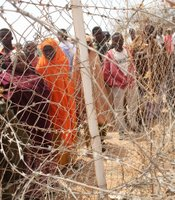 Somali refugees seek information about a move to a different displacement camp due to overcrowding August 24, 2008 in Dadaab, Kenya.