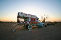 The truck where outsider artist Leonard Knight sleeps. It's painted in the same style as his monumental work, Salvation Mountain.