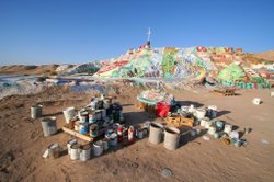 Paint cans are scattered all over the land surrounding Salvation Mountain.