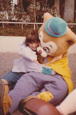 Tammy Carpowich hugs a costumed character at Disneyland circa 1983.