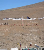 Hillside with flags and families messages, San Jos Mine, Copiapo, Chile. 