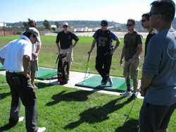 "Injured veterans watch PGA professional ""AB"" Nevarez demonstrate how to stand when teeing off, October 27, 2010 in San Diego, Calif."