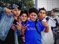 A group of kids hold up gang signs in Los Angeles. 