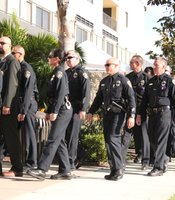 Police officers walk in procession on Rosecrans St. in Point Loma toward the Rock Church, on November 4, 2010.