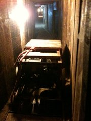 Smugglers used this motorized cart to transport marijuana from a Tijuana warehouse, through the tunnel, to a warehouse in Otay Mesa, San Diego. Six car batteries powered the homemade cart. It has wheels, like those on a train, and travels on rails at about 15 miles per hour.