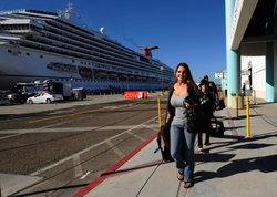 Stranded Carnival cruise ship passengers Jackie Harlan and her family Ryan, 10, and husband Chris are the first passengers to get off the cruise ship at San Diego Harbor on November 11, 2010 in San Diego, California.