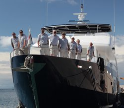 The crew of the Aurora Trust on board their ship, the Fortaleza, in Ventotene port.