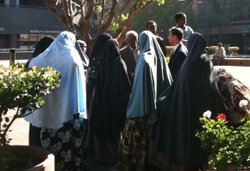 Nima Ali Yusuf's family gather around her defense attorney after a hearing in November 2010.
