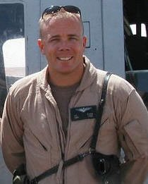 Josh Evans stands in front of a Huey helicopter in Iraq in 2004.