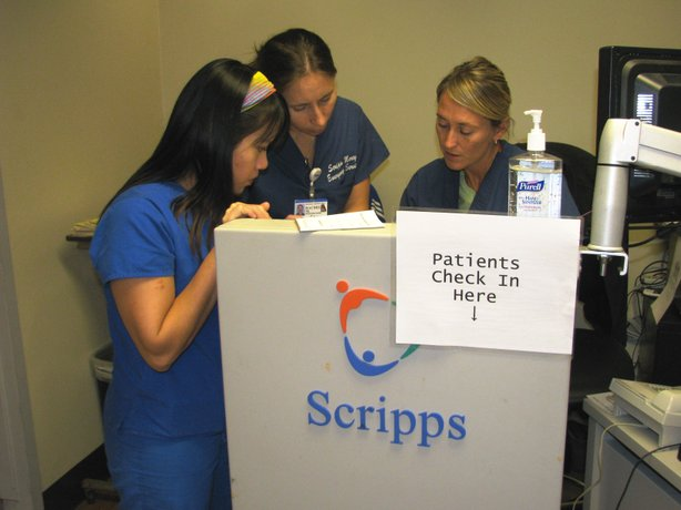 Nurses at Scripps Mercy Hospital in Hillcrest try to keep things moving in the emergency department.
