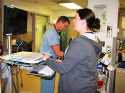 Emergency room Dr. Scott Freiwald examines a patient as nurse Becky Welburn enters all of the relevant information into a computer so all hospital staff can have easy access to it.