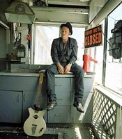 Tom Waits, posing like one of the down and out characters about which he writes songs.