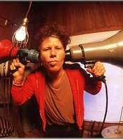 Tom Waits, fisheye style with bullhorns.