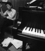 Circa 1980, Hollywood, Los Angeles– Tom Waits Relaxing by Piano –Image by © Henry Diltz/CORBIS