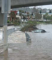 A Porsche is trapped on Mission Center Road as the San Diego River overwhelmed it&#39;s banks and closed many roads.   
