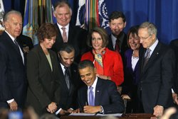 U.S. President Barack Obama (C) signs legislation repealing military policy law during a ceremony December 22, 2010 in Washington, DC. President Obama signed into law a bill repealing the &#39;don&#39;t ask, don&#39;t tell&#39; law against gays serving openly in the military.