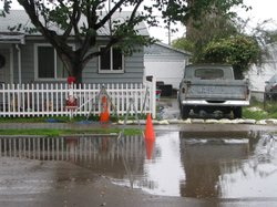 Water floods the street in front of Martin Ammerman's Linda Vista home on December 29, 2010. The storm drain pipe underneath the home has collapsed and isn't scheduled to be replaced until Spring 2012.