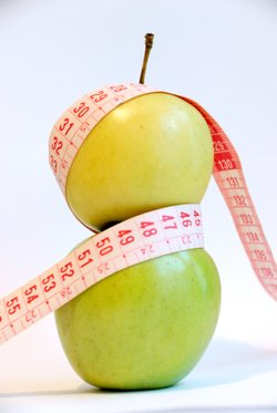 """D is for Diet,"" September 2008. Apples pictured with measuring tape.  Photo by Gloria Garcia."