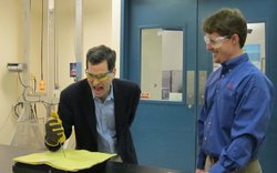 David Pogue tries to stab through Kevlar as Tucker Norton watches.