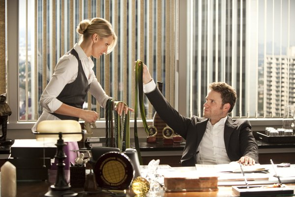 "Cameron Diaz gets oogled by her boss played by Seth Rogen in ""The Green Hornet."""